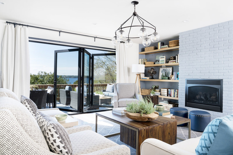 The living room is the heart of the DIY Network Ultimate Retreat 2017, anchored by folding glass doors that provide a stunning and expansive view of Lake Champlain.