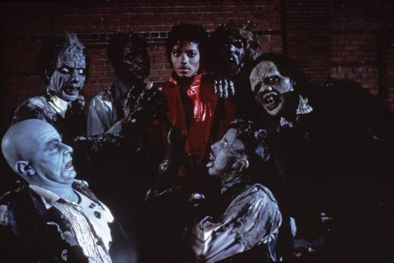 Michael Jackson surrounded by Zombies on the set of the filming of Thriller
