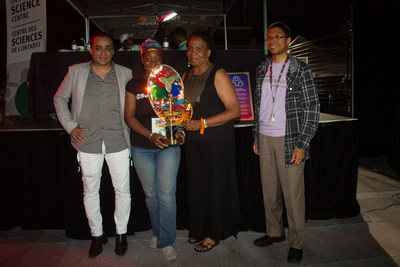 The Ontario Science Centre awarded the eighth annual Innovation in Mas' Award to Sunlime Canada led by Dwayne Gunness for  Journey to Valhalla at the Peeks Toronto Caribbean Carnival King and Queen Competition and Show. Journey to Valhalla was designed by David Amow and performed by Sileena Amow. Pictured (L to R) Mark Itwaru, Peeks Creator and CEO; Isha Grant accepting the Award on behalf of Sunlime Canada; Denise Herrera-Jackson, CEO, Peeks Toronto Caribbean Carnival; Walter Stoddard, Award Judge and Senior Scientist, Ontario Science Centre. (Photo Credit: Anthony Berot) (CNW Group/Ontario Science Centre)