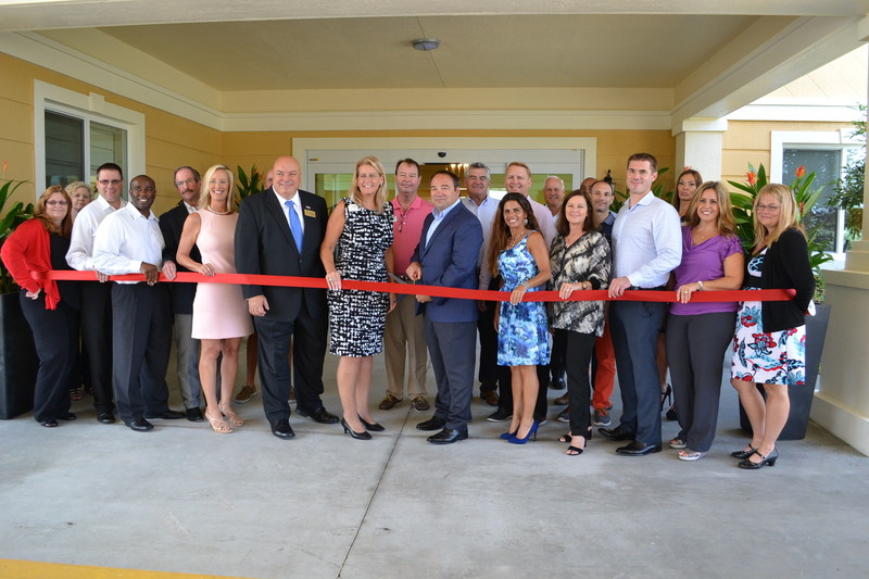 The CEO of Discovery Senior Living, along with senior management and board members from the Fort Myers Chamber of Commerce and distinguished attendees, cut the ribbon to celebrate the completion of Southwest Florida's newest senior living community