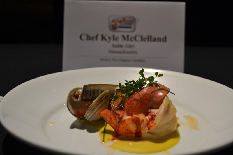 """Chef Kyle McClelland of Saltie Girl in Boston, MA presented his winning dish, """"Modern New England Clambake"""" featuring butter-poached Gloucester, MA lobster, linguica, native corn, heirloom tomatoes, potatoes in a uni lobster sauce at the 2017 Great American Seafood Cook-Off  in New Orleans, LA."""