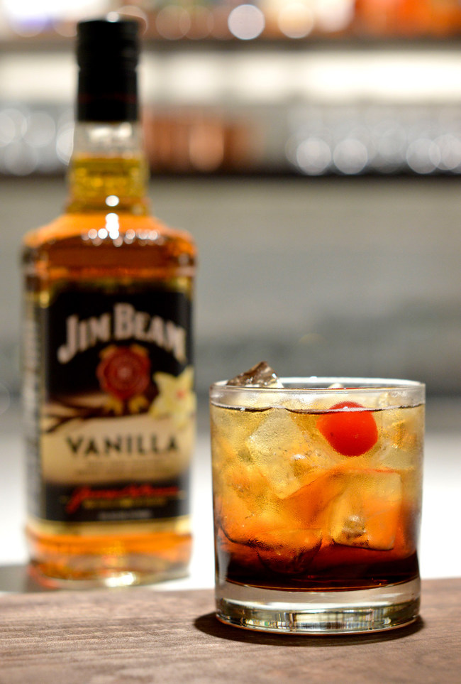 Enjoy Jim Beam® Vanilla with cola and a cherry garnish.