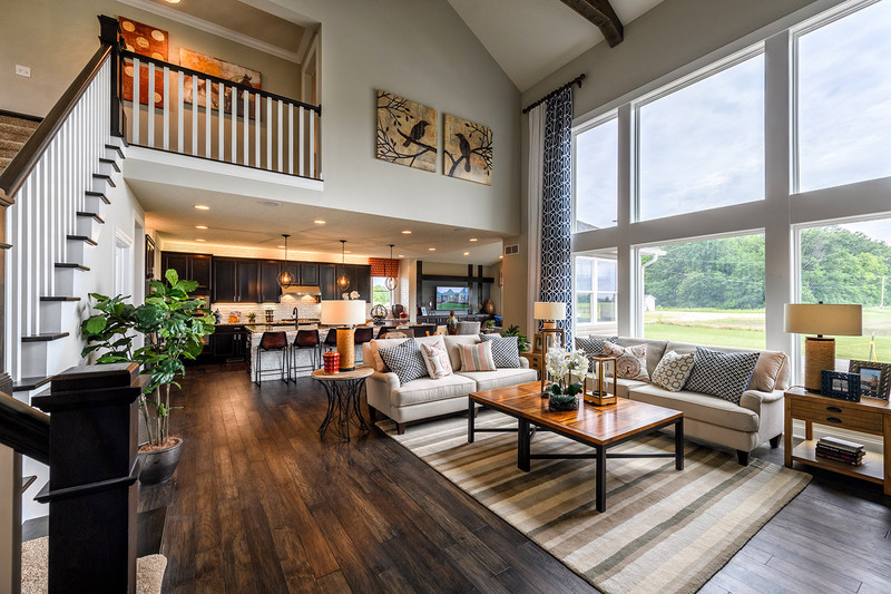 The open floor plan of the award-winning Schumacher Homes Olivia B provides ample space for family gathering and entertaining. With a wall of windows, natural light abounds!