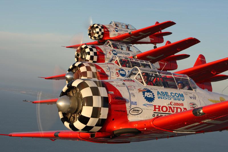 The AeroShell Aerobatic Team demonstrate an echelon formation.