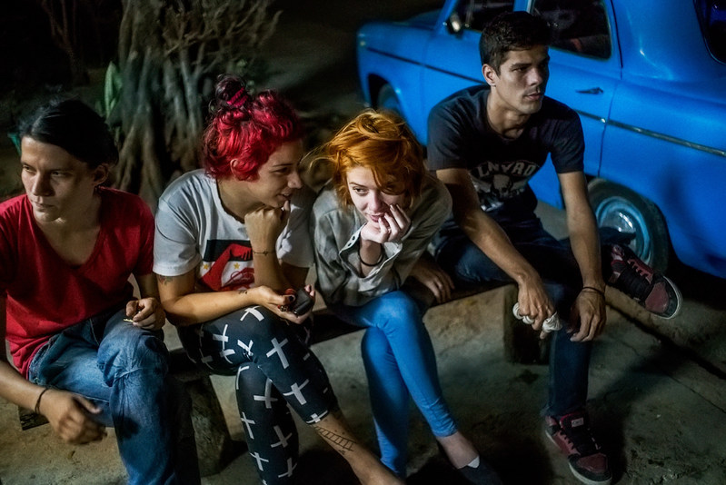 Michael Christopher Brown--Helen and friends wait for their $1.00 cheese pizzas in Playa neighborhood, Havana (Annenberg Space for Photography)