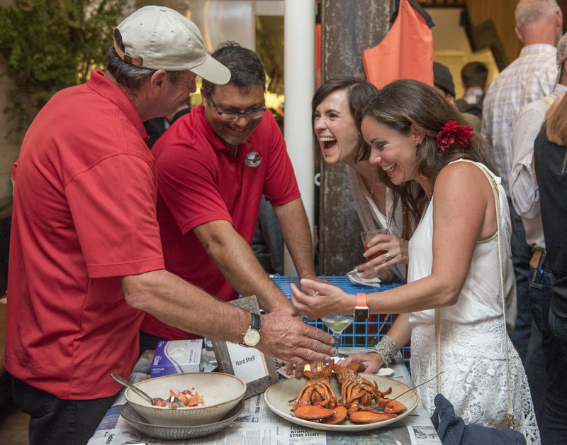Lobstermen Skip Collins and Jason Joyce explain the difference between Maine New Shell and Hard Shell Lobsters to guests at the Maine After Midnight chef industry night at The Progress on Monday, Aug. 7, 2017 in San Francisco. The event was held for chefs to learn about the sustainability, heritage and culinary applications of Maine Lobster. For information on Maine Lobster, visit www.lobsterfrommaine.com. (Peter Barreras/AP Images for The Maine Lobster Marketing Collaborative)