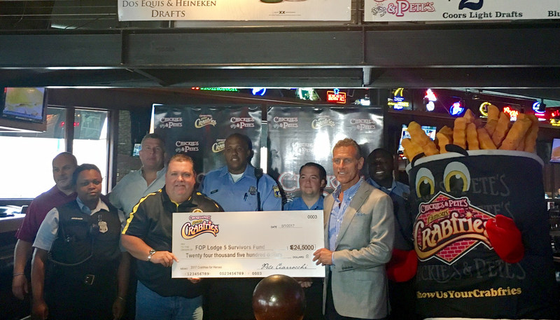 Aug. 8, 2017 Philadelphia; Chickie's & Pete's founder and CEO Pete Ciarrocchi (far right), presents a check for $24,500 to  John McNesby, President of the Fraternal Order of Police Lodge 5 Philadelphia.  The check represents a record total raised by Chickie's & Pete's Crabfries for Heroes July 2017 fundraiser. Proceeds benefit the families of fallen police officers.