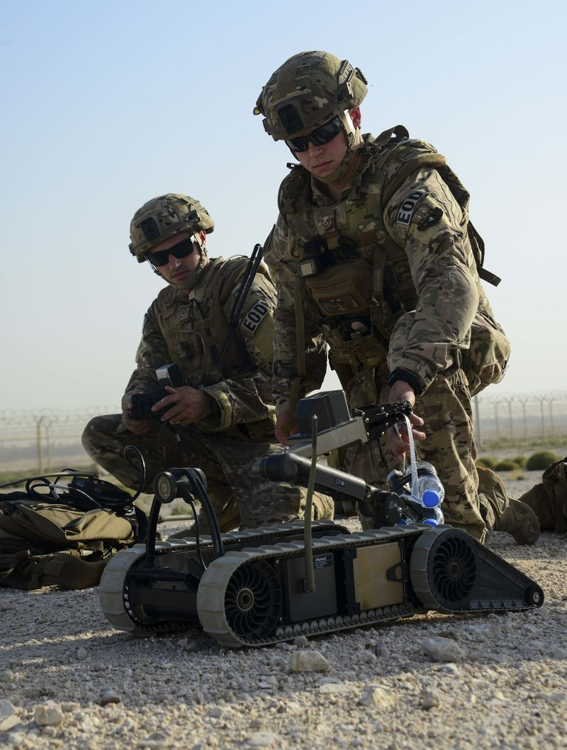 Tech Sgt. David Dickey and Staff Sgt. Darrel Linkus, both 379th Expeditionary Civil Engineer Squadron explosive ordnance disposal craftsmen, prepare to send the Pacbot 310 robot down to the location of an improvised explosive device during a training exercise May 19, 2016, at Al Udeid Air Base, Qatar. EOD Airmen are trained to detect, disarm, detonate and dispose of explosive threats all over the world. (U.S. Air Force photo/Senior Airman Janelle Patiño/Released)