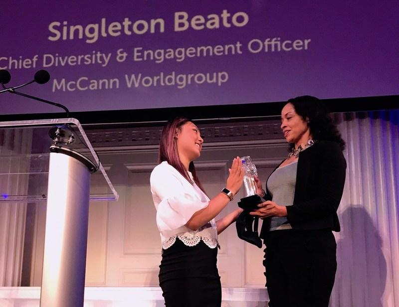 Singleton Beato (r.) receives Gladiator award from 4A's/MAIP's Tien Dang.