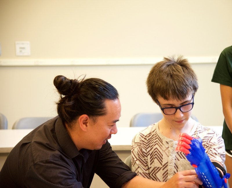 The Helping Hand Project at UNC Charlotte delivers prosthetic arm to young patient.