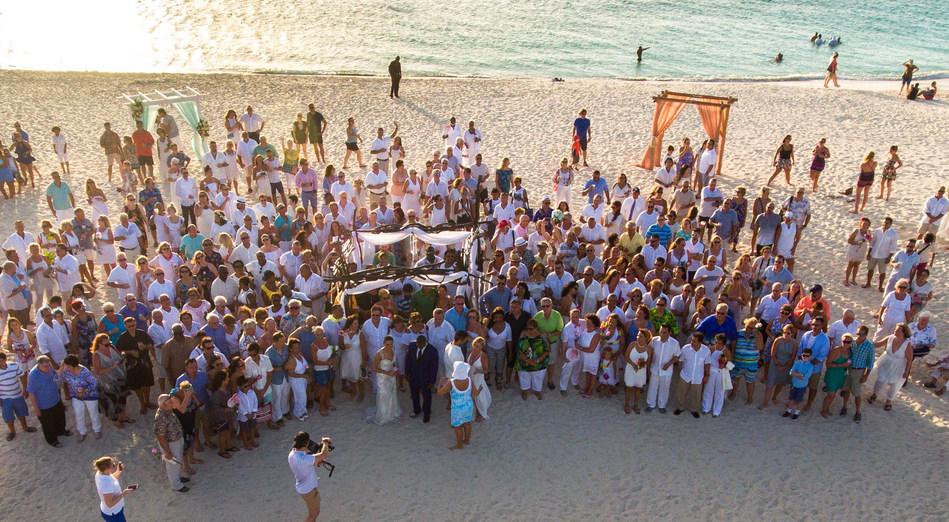 "160 Couples ""renewed their I Do's"" at sunset on Eagle Beach, Aruba, Aug. 8."