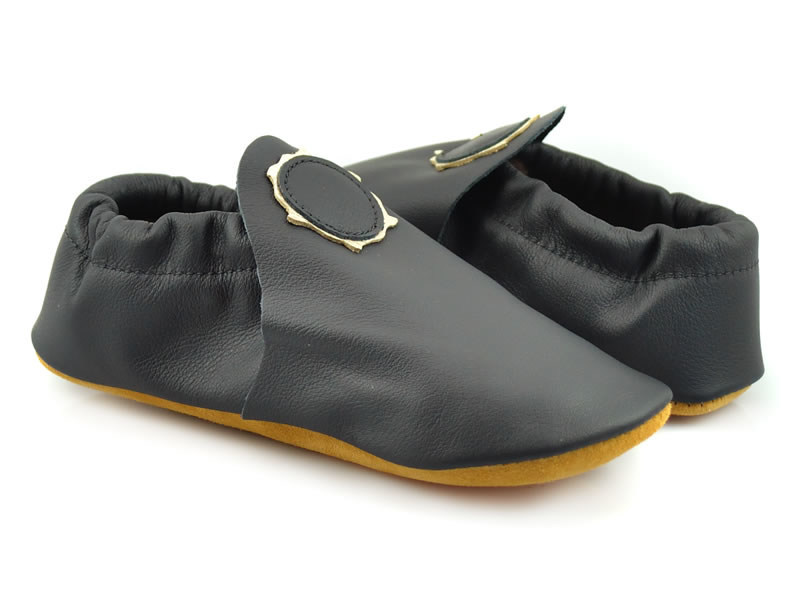 Softstar's buttery soft eclipse moccasins feature a hand-cut design to represent the sun's corona.