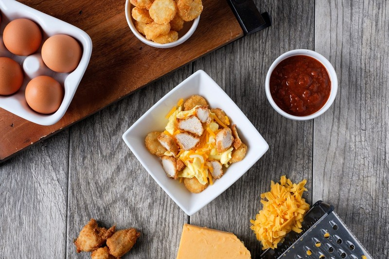 The Hash Brown Scramble features Chick-fil-A Nuggets (or sausage), crispy Hash Browns, scrambled eggs and a Monterey Jack and cheddar cheese blend. It is served with Jalapeno Salsa.