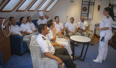 Captain Nathaly Albán briefs her crew on Celebrity Xploration in the Galapagos
