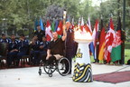 Retired MCpl. Jody Mitic, 20-year Canadian veteran and official ambassador of the Invictus Games Toronto 2017, lifts Invictus Spirit Flame in lighting ceremony in Kabul, Afghanistan. Photo Credit: Tahmina Saleem (CNW Group/Invictus Games Toronto 2017)