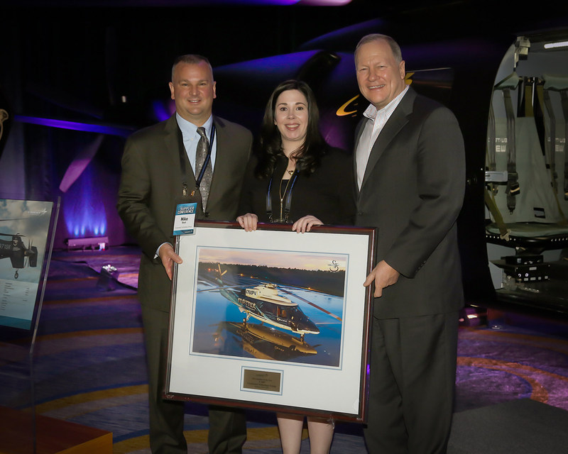 CTG accepts Sikorsky's 2016 Supplier of the Year Award. From left to right: CTG Chief Sales Officer Mike Boyd and Sr. Corporate Account Manager Karen Thacke, Sikorsky President Dan Schultz. © Sikorsky Aircraft Corporation 2016. All rights reserved.