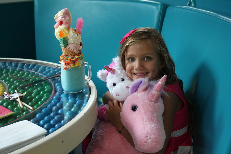 6 year old Imaginormous Winner, Giselle Decker, enjoying her unicorns at Dylan's Candy Bar