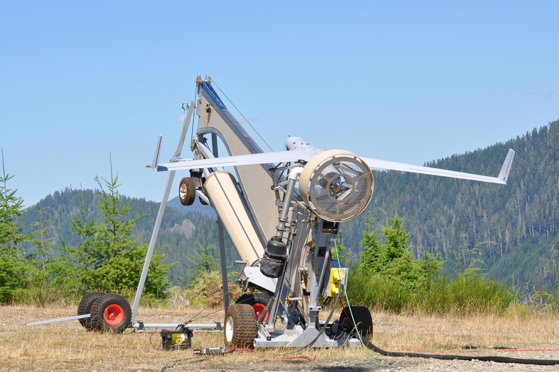 ScanEagle prepares to launch during a wildfire