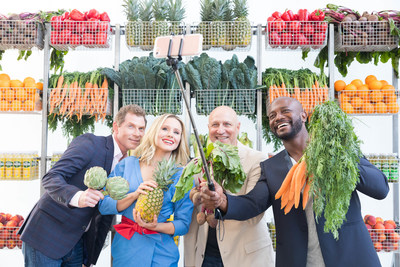 Bobby Flay, Kristen Bell, Tom Colicchio and Taye Diggs take a fruit and vegetable selfie at Naked Juice's #DrinkGoodDoGood campaign launch event in Manhattan. For every selfie shared using the campaign hashtag, Naked Juice will donate 10 pounds of produce to communities in need.