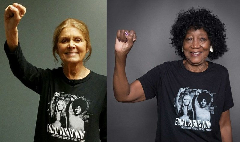 Gloria Steinem and Dorothy Pitman Hughes wear #EqualRightsNow t-shirts in support of the ERA Coalition's efforts to pass and ratify the Equal Rights Amendment.