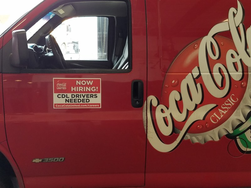 Atlanta Coca-Cola Bottling Company is growing its team and using its trucks as a creative way to communicate the job opportunities.