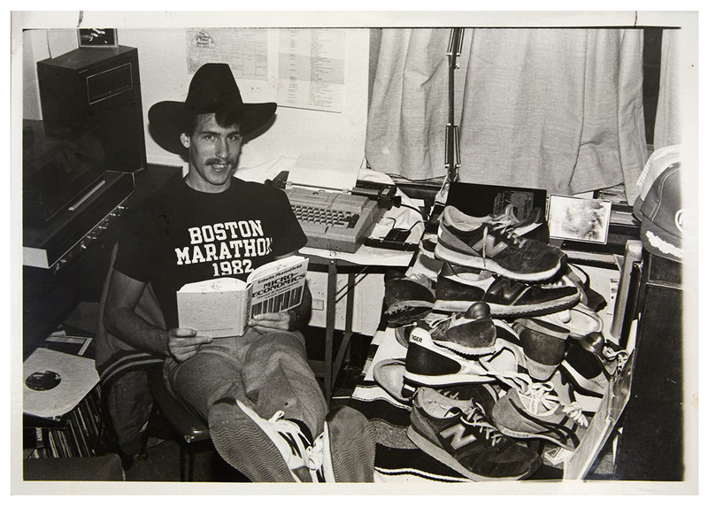 SHOES FOR CREWS CEO Stuart Jenkins, in a photo from 1980, surrounded by his collection of New Balance running shoes.