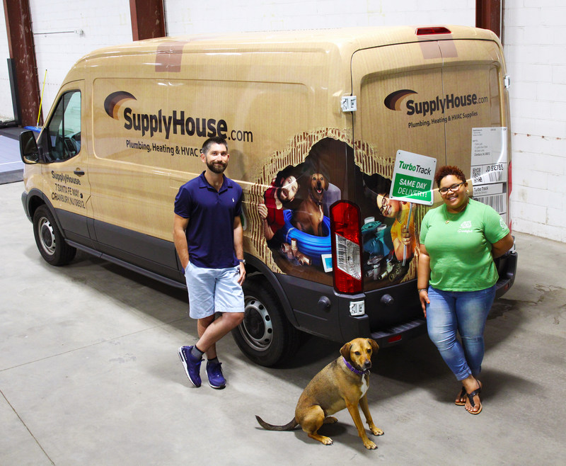 Image of SupplyHouse.com employees (and four legged friend) featured on their new TurboTrack van!