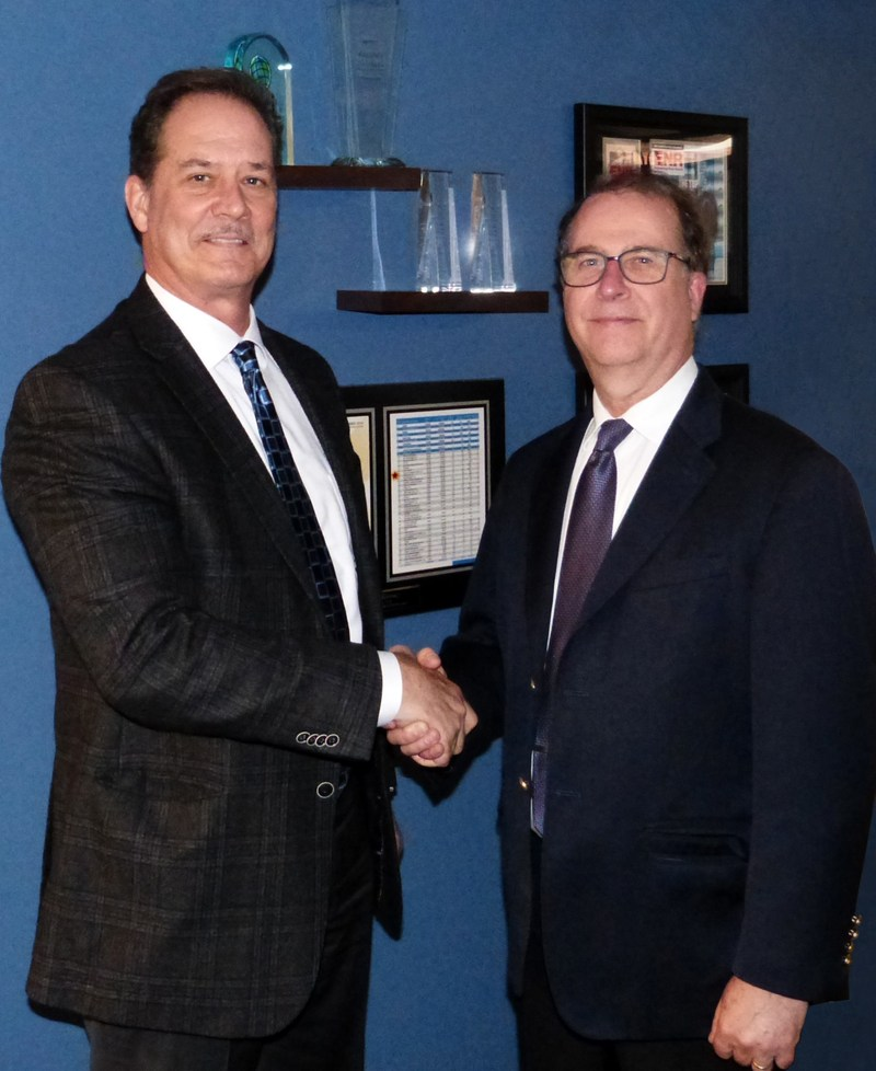 CEO Al Hollenbeck (right) shakes new President Jeff Plymale's hand (left)