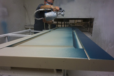 Polyurethane shutters being painted Maxi Teal color at the Nu-Wood facility in Indiana.