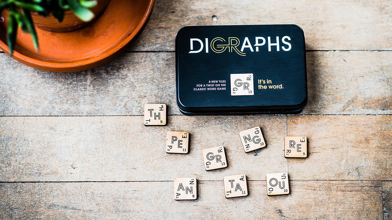 A simple twist to a classic game, Digraphs comes with 8 tiles, each with 2 letters instead of 1. (CNW Group/Digraphs Game Corporation)