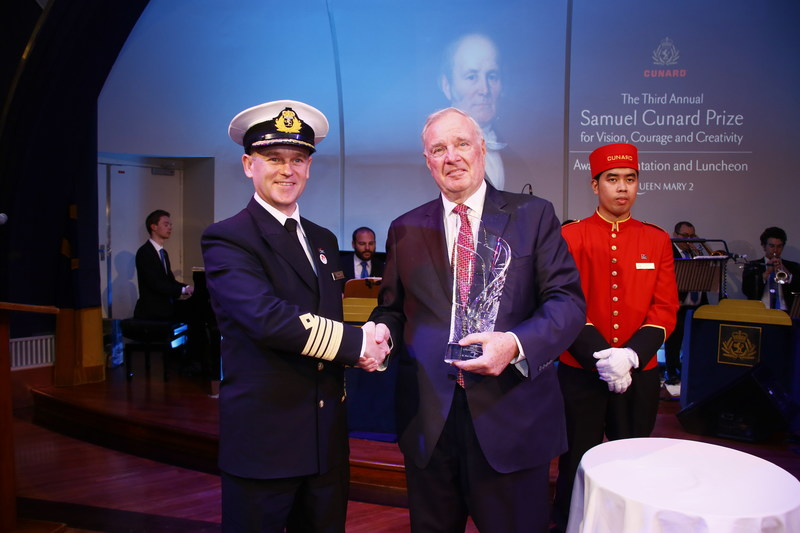 On board Cunard's flagship Queen Mary 2, Captain Stephen Howarth congratulates former Prime Minister, The Right Honourable Paul Martin, on receiving the Third Annual Samuel Cunard Prize for Vision, Courage and Creativity.