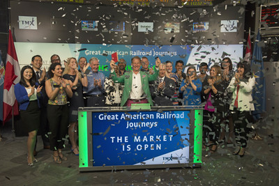 Michael Portillo, Broadcaster and Presenter of Great American Railroad Journeys joined Alison Simpson, SVP, Marketing and Branding, TMX Group to open the market. The BBC travel documentary series follows Michael Portillo as he uses an 1879 copy of Appleton's Guidebook to the railroads to travel across the United States and Canada. (CNW Group/TMX Group Limited)