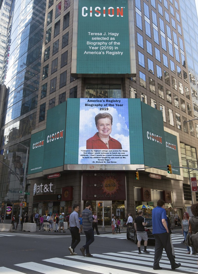 Bio of the Year Recipient, Teresa Hagy, Celebrates a Lifetime of Achievement in Education, Enjoys Special Times Square Appearance.