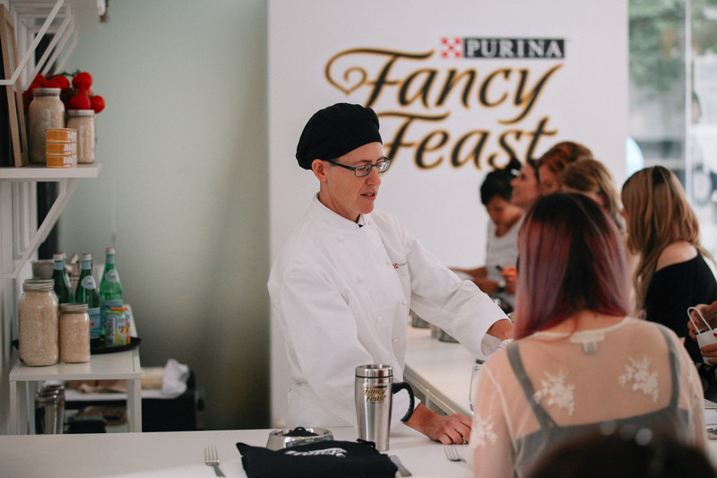 """Purina Fancy Feast is inviting Torontonians down today, August 12th, to check out the ultimate Cat Foodie Pop-Up Shop at 25 Charlotte St. Come visit to learn how great taste can be on """"Le Menu"""" every day of the week for your feline friend, thanks to Fancy Feast. (CNW Group/Nestle Purina PetCare)"""