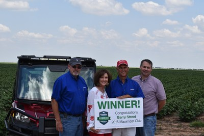 FiberMax grower Barry Street of Claytonville, Texas, won the sweepstakes drawing for a Polaris Ranger XP 1000 EPS. He and his wife, SuDe Street, received congratulations from Bayer Sales Representative Stan Warren (far left) and Southwest District Manager Dan Koch (far right).