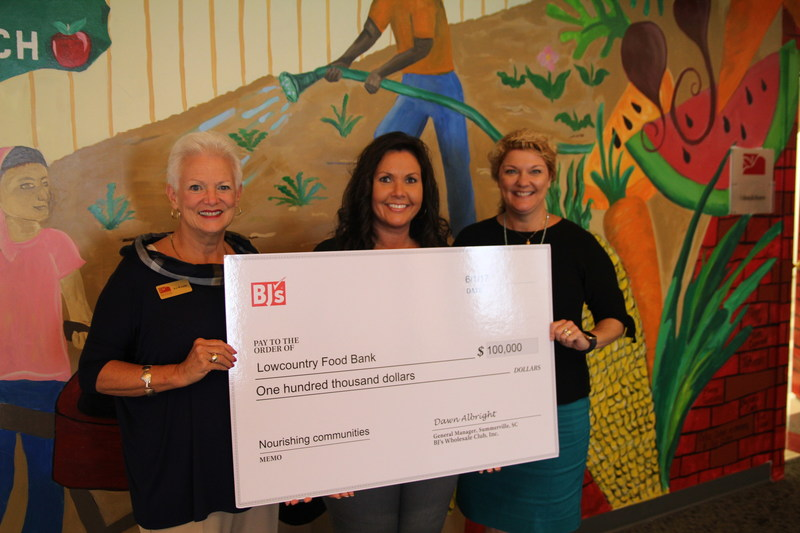 Dawn Albright, General Manager of BJ's Wholesale Club in Summerville, S.C. (center), presents a $100,000 donation from BJ's Charitable Foundation to Pat Walker, President and CEO, Lowcountry Food Bank (left) and Kathryn Douglas, Chief Development Officer, Lowcountry Food Bank (right) to help store and distribute perishable foods to those in need.