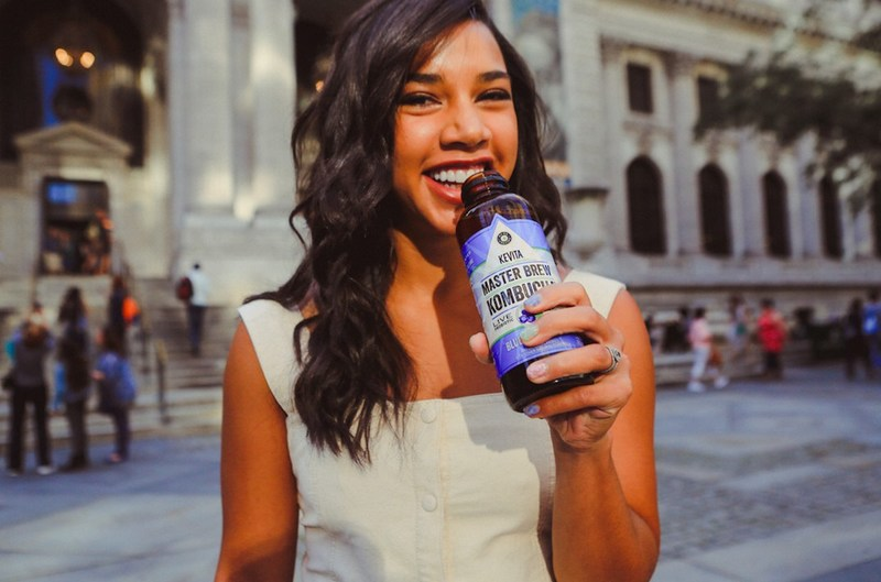 Hannah Bronfman sips Blueberry Basil, KeVita's new Master Brew Kombucha flavor.  (Photo Credit: Mel D. Cole for KeVita)