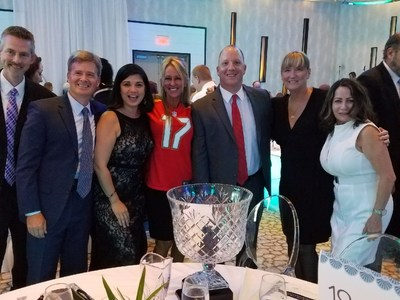 HomeBanc team members with BusinessWoman of the Year in her Tampa Bay Buccaneers jersey