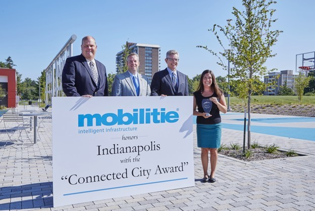 "Mobilitie presents the ""Connected City Award"" to the city of Indianapolis and Full Circle Solutions CEO Lauren Riga. Pictured left to right: Mobilitie Regional Director Scott Hoff, Indianapolis City Council Minority Leader Michael McQuillan, Mobilitie Central Region Vice President Mitch Wywiorski, and Full Circle Solutions CEO Lauren Riga."