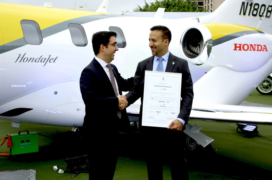 Roberto Honorato, the Superintendent of Department of Airworthiness, National Civil Aviation Agency - Brazil, presents the type certificate to HACI.