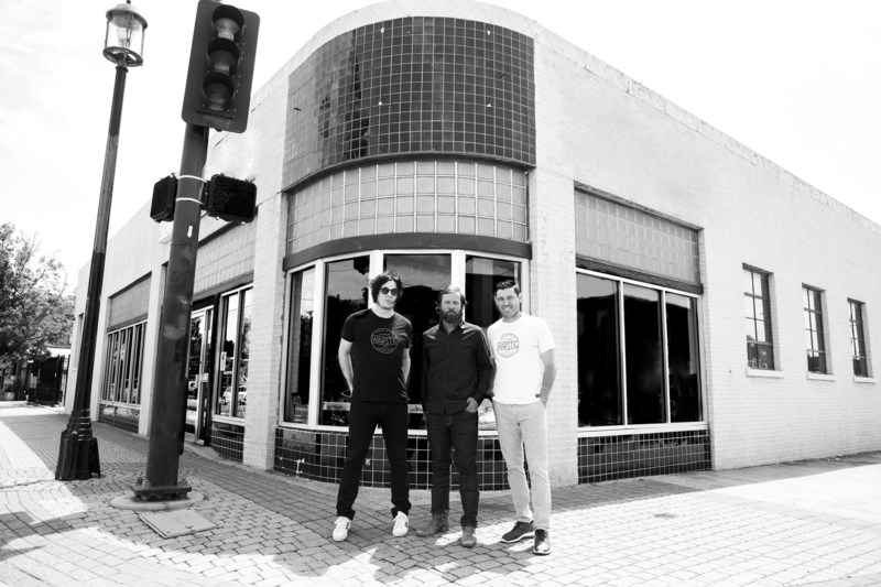 Warstic owners, Jack White, Ben Jenkins and Ian Kinsler stand in front of future Warstic Headquarters in Deep Ellum, Dallas