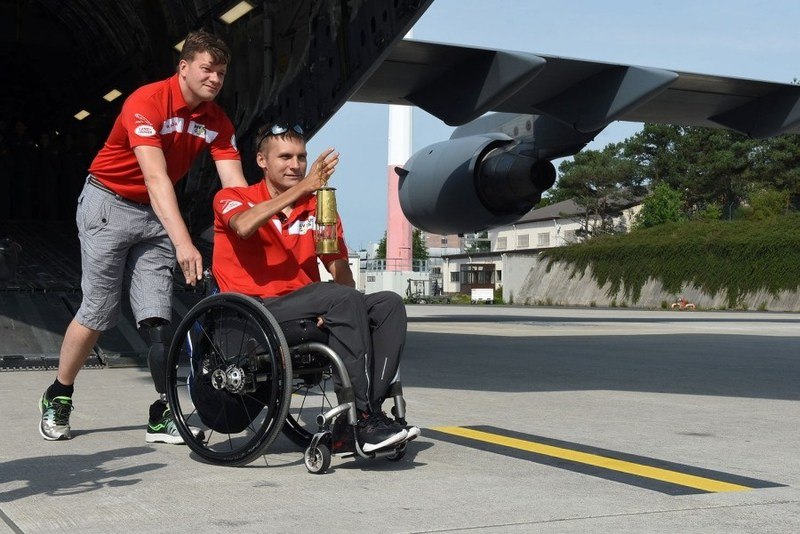 Simon Mailloux, a major with Canadian Forces, pushes Chris Klodt, a former Canadian Forces soldier on Tuesday, Aug. 15, 2017, at Ramstein Air Base, Germany. Klodt carried the Spirit Flame, a symbol of the unconquerable spirit of the Invictus Games wounded warriors. Mailloux and Klodt were injured in Afghanistan. (Photo Credit: JENNIFER SVAN/STARS AND STRIPES) (CNW Group/Invictus Games Toronto 2017)