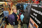 Staples Canada president Mary Sagat walks through the backpack aisle with general manager Kim Stuckless during a store visit in Belleville, Ont. Tuesday, Aug. 15, 2017, as part of preparations for the busy back-to-school season. Sagat was appointed first female president of Staples Canada one year ago. On the cusp of its busiest season, the company launched its Back-to-School Centre and its annual School Supply Drive, which helps students in need go back-to-school with the essential supplies. Information at www.staples.ca/backtoschool. (CNW Group/Staples Canada Inc.)
