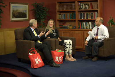 Kirk Saville, executive director, BJ's Charitable Foundation (left), surprises Rebecca Levesque, teacher at Suzanne M Smith Elementary School (center) with Wayne Harvey, anchor on WABI TV5 in Bangor, Maine on Wednesday, August 16, 2017 with the announcement that BJ's Wholesale Club has donated $100,000 to help fund classroom projects in Maine through DonorsChoose.org.