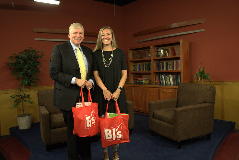 Kirk Saville, executive director, BJ's Charitable Foundation (left), presents Rebecca Levesque, teacher at Suzanne M Smith Elementary School (right) with the announcement that BJ's Wholesale Club has donated $100,000 to help fund classroom projects in Maine through DonorsChoose.org on Wednesday, August 16, 2017 in Bangor, Maine.