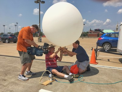 Dr. Bob Pasken, Ph.D., Saint Louis University meteorology professor and head of the launch team, releases a test weather balloon in preparation for the upcoming solar eclipse.