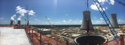 A panoramic view of a 1.4 million-pound Unit 3 steam generator being lifted into place at the Vogtle nuclear expansion near Waynesboro, Georgia. The cooling towers for the operational Vogtle Units 1 & 2, as well as the new Units 3 & 4, are in the background.