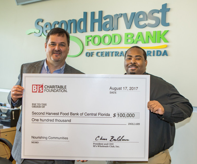 Anthony Newsome, General Manager of BJ's Wholesale Club in Orlando, Florida, presents a donation of $100,000 from BJ's Charitable Foundation to Greg Higgerson, Vice President, Development, Second Harvest Food Bank of Central Florida on Thursday, August 17, 2017.