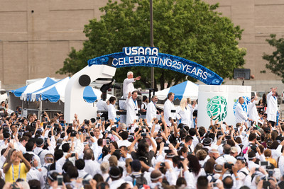 USANA founder Dr. Myron Wentz and USANA R&D scientists enter the event on a science-themed float