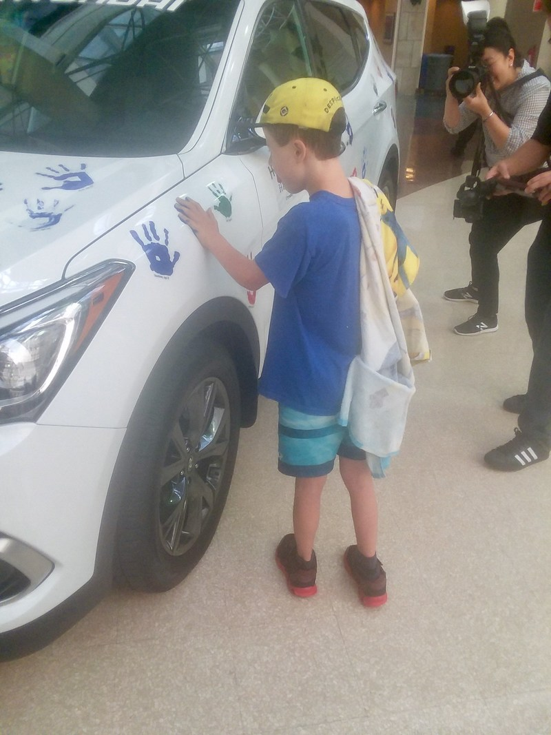 Young Boy Participates in a Hyundai Hope on Wheels Handprint Ceremony at University Hospitals Rainbow Babies & Children's Hospital in Cleveland on August 15th